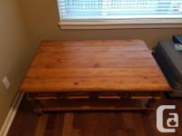 Solid wood coffee table with 2 pull out drawers and a
