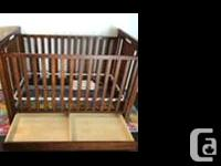 Solid wood crib with storage drawers. Great price