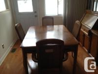 Dining table with buffet and hutch with four chairs.
