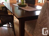 This modern dining room table has simple, elegant