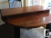 Solid dining room table with 3 leaves that can be