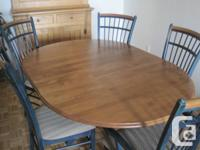 Attractive solid wood dining table on pedestal with 5