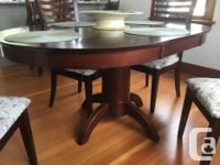 Beautiful solid cherrywood table,round,with a leaf.Four