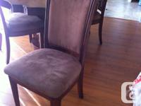 We are selling our solid wood dining table and 4