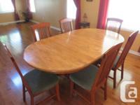Beautiful table and chairs, like new. Solid wood dining