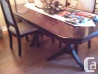 We have a beautiful 8 seat solid wood diningroom table