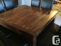 SOLID wood table (Probably weighs 150-200lbs). This