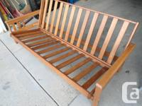 Very good condition solid wood  futon frame,  converts