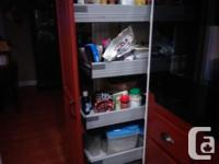 Solid wood door and frame cabinets. Includes pull out