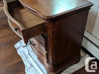 Two solid wood nightstands. In very good condition, one