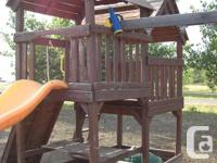 Solid and sturdy wood play structure bought from Costco