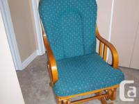 Solid wood rocking chair for sale. Good condition.