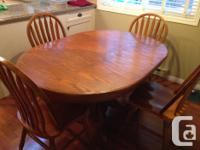 Solid wood pedestal table with 4 chairs and leaf