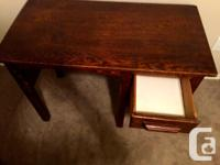 We are selling a small, solid wood vintage desk.