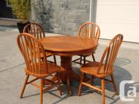 Solid wood round table and 4 chairs. Not pristine by