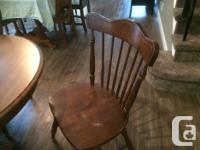 Palliser solid wood table with two leafs. Each leaf is