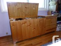 This is a solid wood toy chest on one side with drawers