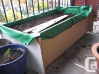 We have several solid wooden planter boxes, some with
