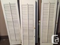 3 pairs of solid wood shutters used indoors. $20 each