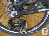 Nice little folding bicycle. Shimano derailleur, steel
