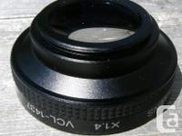 SONY 1.4X TELE CONVERSION LENS WITH 37mm THREADS.