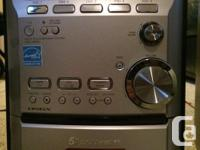 Five disc CD changer with CD pop-up loading mechanism
