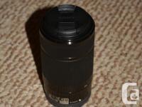 Sony E Mount 55-210mm f/4.5-6.3 OSS zoom lens for sale.