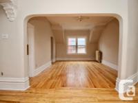 hardwood floors, large living room, and dining room,