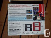 Includes: -DSi XL -Mario Kart -3 pre-installed titles