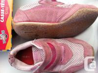 These HUNCHES tennis shoes are pink. They are velcro so