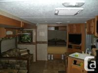 Get into this great family oriented campground, trailer