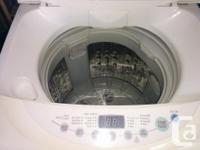 Apartment sized 120 volt stacking washer and dryer.
