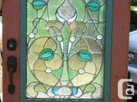 "Beautiful 23"" x 46"" art glass window circa 1900,"