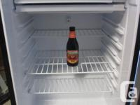 Small mini- fridge. Clean. Works perfectly. I have a