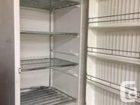 "Stand up freezer works great 66"" h x 30""w x 28""d 4"