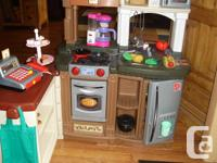 Very gently used Child's delux kitchen. Includes
