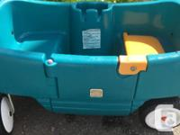Used condition. Has a little door, cup holders, and a