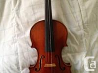 This is a Stephan Petrov workshop violin made after a