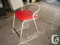 Special little bar stool. Quite comfy & & tough. Red