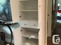 Attractive white cabinet like new. Shelves top and