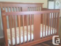 Storkcraft 3 in 1 baby crib with mattress in good