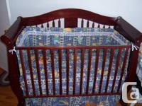 An attractive dark wood structure child crib in