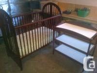 Cherry Wood Storkcraft crib manufactured in Richmond