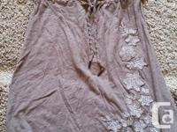 Light brown strapless dress with white flower accents.