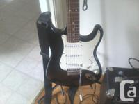 Strat style guitar & amp with stand, strap, cables soft