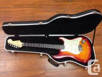 2004 - Fender Stratocaster Deluxe, 3 colour wineburst,