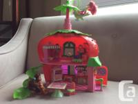 A cute little strawberry house with 3 dolls including
