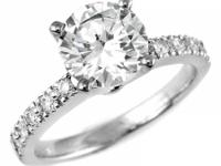 Striking in style, this beautiful solitaire engagement