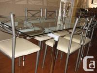 Europa's sturdy tempered glass table top and polished