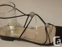 "Stuart Weitzman women's ""Tweety"" flat sandal. An"